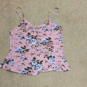 A floral tank top with ruffles